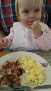Willow attacking the bacon at breakfast.