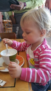 Willow enjoying her babychino at Mugg and Bean